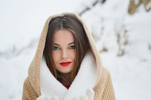 smiling woman with winter coat during daytime