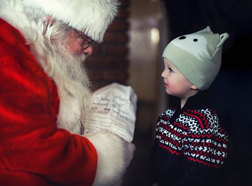 photo toddler in black sweater standing in front of Santa Claus free for commercial use images