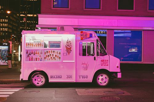 photo white ice cream truck parked on road free for commercial use images