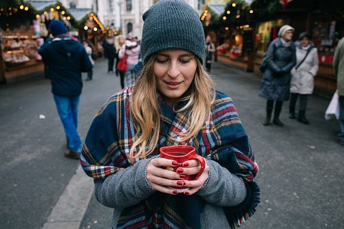 photo woman holding cup of coffee free for commercial use images