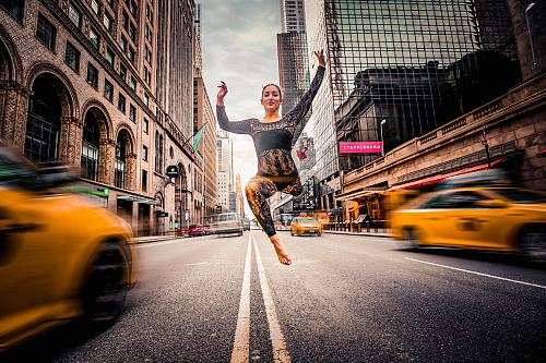 photo woman jumping on road free for commercial use images