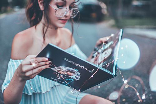 photo woman reading book free for commercial use images