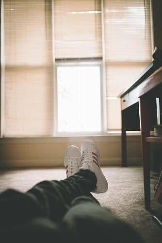 clothing person on floor beside desk footwear