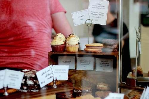 shop cupcakes on wooden display rack cake