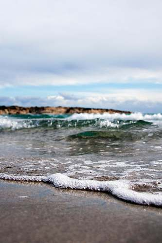 ocean waves under white cloudy sky at daytime sea
