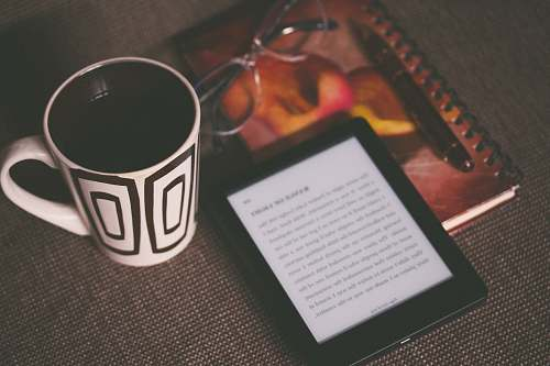 photo reading black E-book reader beside white and black mug coffee cup free for commercial use images