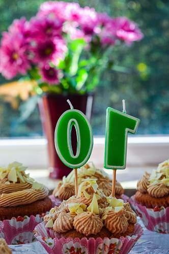 food cupcakes with green and white number 10 candle cake