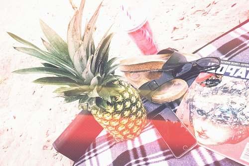 fruit pineapple beside phone and speaker pineapple