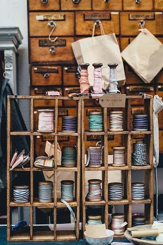vintage assorted threads on rack craft