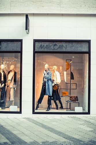 photo person display of mannequins with dresses inside the building shop free for commercial use images