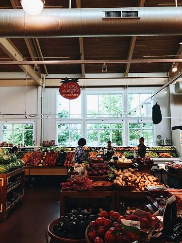 person group of people inside mart at fruit section grocery store