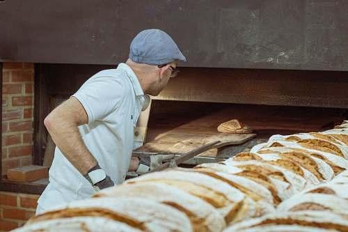 person man wearing white polo shirt bakery