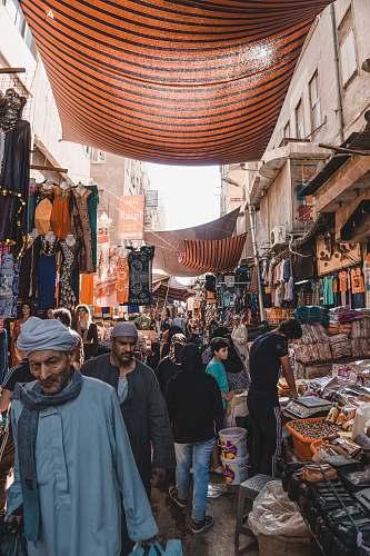 person people between vendors market