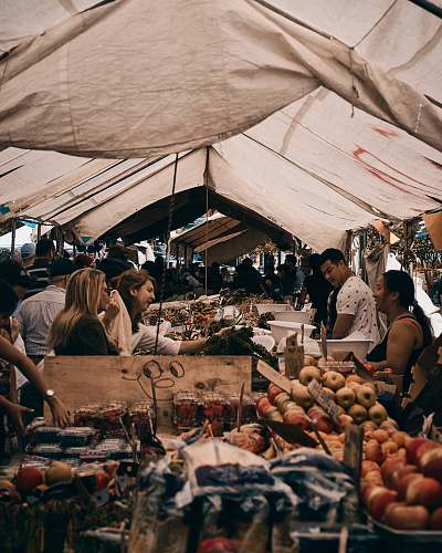 person people in market at daytime tent