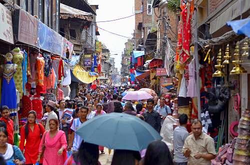 person people walking on market during daytime market