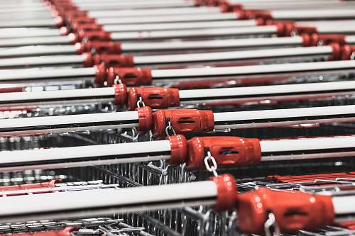 person photo of stacked shopping carts people