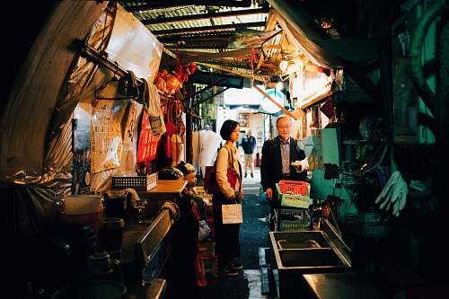 person woman and man standing inside house market