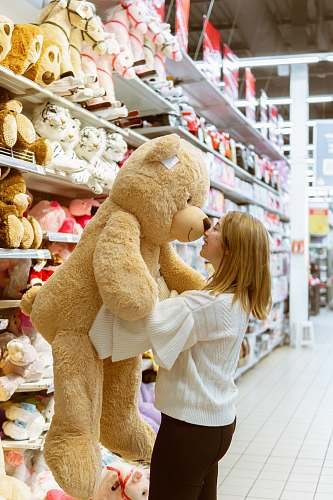shop woman carrying life size bear plush toy teddy bear