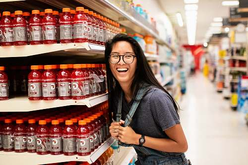 person woman laughing while standing beside Gatorade bottlles accessories