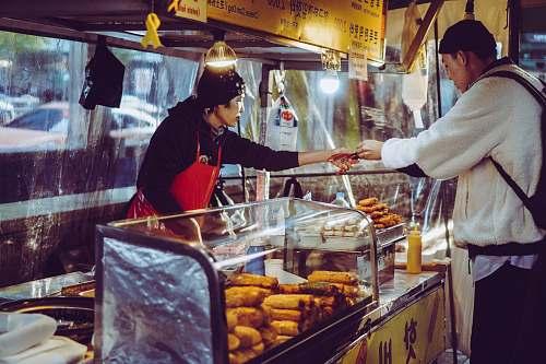 person woman selling food helmet