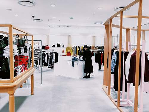 shop woman standing inside clothing area boutique