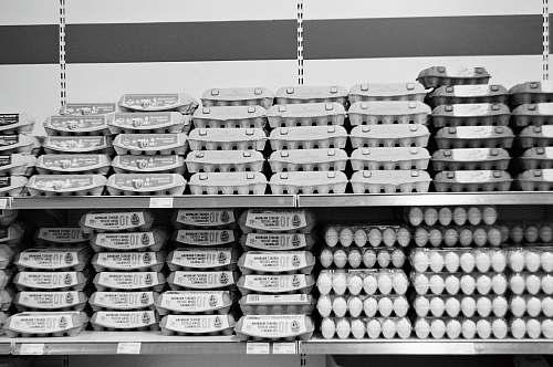 black-and-white eggs on trays shelf