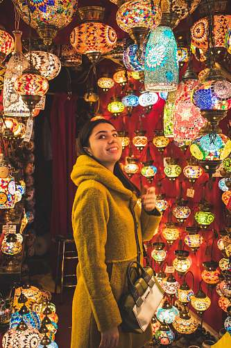 photo shop woman looking at pendant lamps bazaar free for commercial use images
