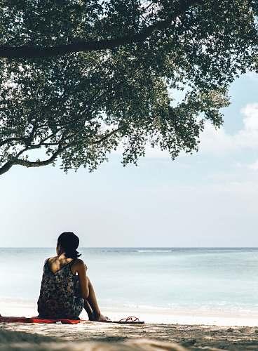 person woman beside tree human