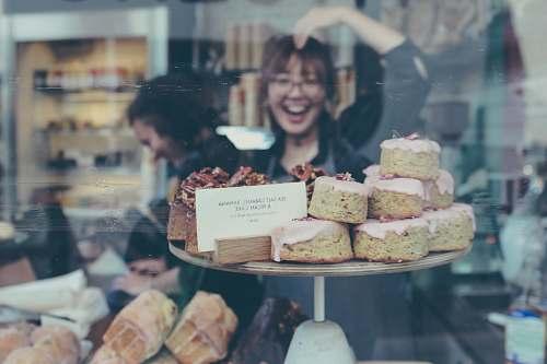 human reflection of smiling woman on food display shelf people