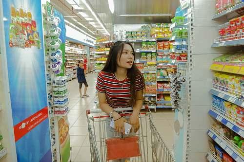 human woman inside grocery strore market