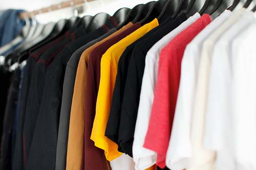 clothing closeup of hanged shirts on rack shirt