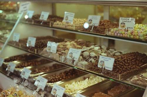 photo bakery assorted pastries in display counter confectionery free for commercial use images