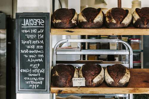 photo bread breads on brown wooden shelf bakery free for commercial use images