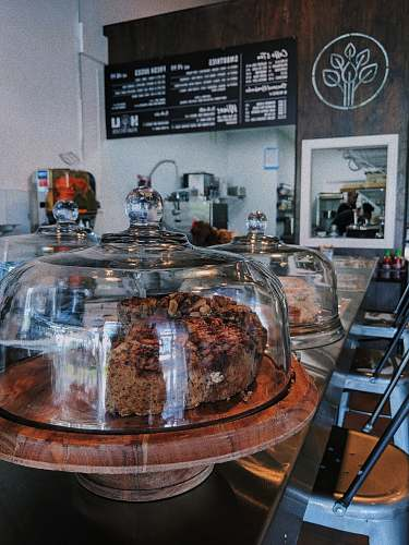 bakery coffee shop sells two cakes inside dome glasses confectionery