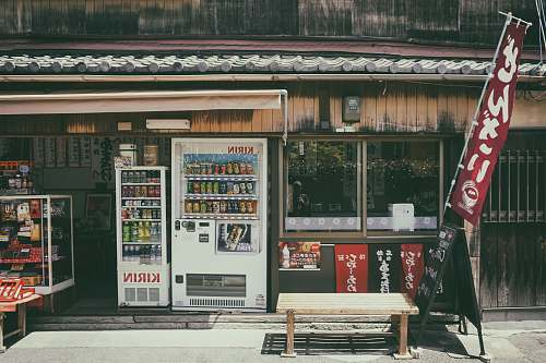 japan Kirin vending machine near glass display counter bench