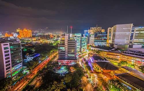 city long-exposure photo of urban city with lights urban