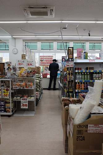 human man standing on store counter during daytime person