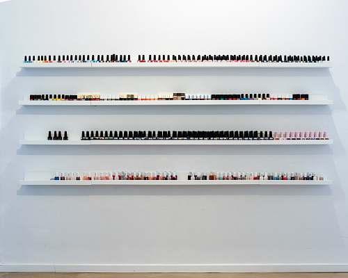 photo shelf nail polish bottles on rack grey free for commercial use images