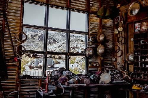window scrape metals on table near glass window room