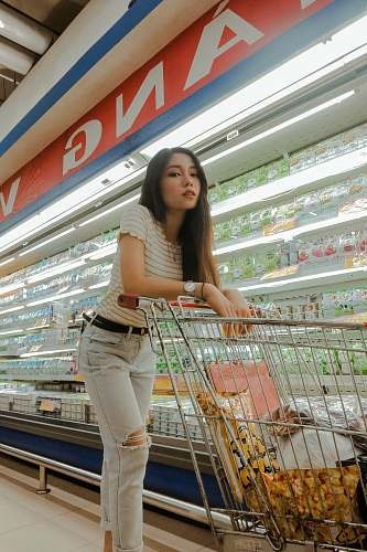 supermarket woman near beverage cooler grocery store
