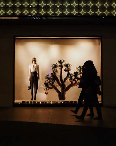 human woman walking inside mall person