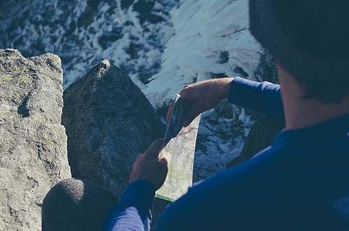 climbing person holding map mountain