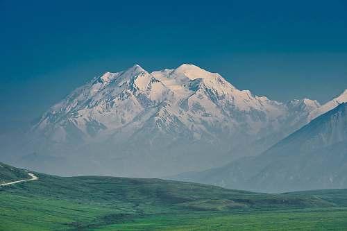 nature grass field and glacier mountain mountain range