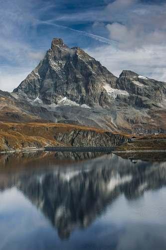 nature gray rocky mountain under blue sky landscape