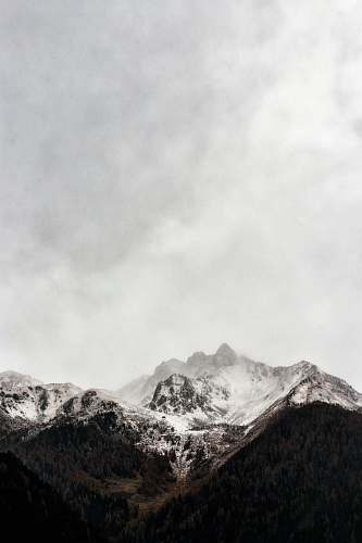 nature iced cap mountain under gray sky during daytime photography grey