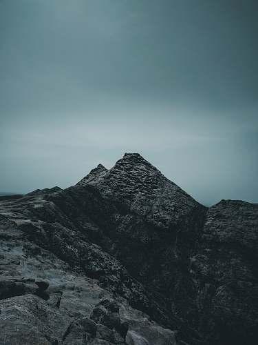 nature rock mountain under cloudy sky crest