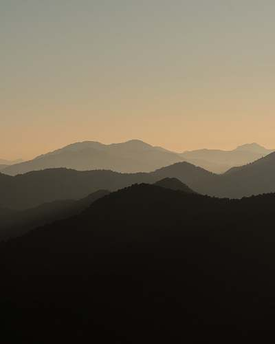 nature silhouette of mountains during daytime mountain range