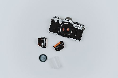 photo black Canon film camera with two films in flat lay photography free for commercial use images