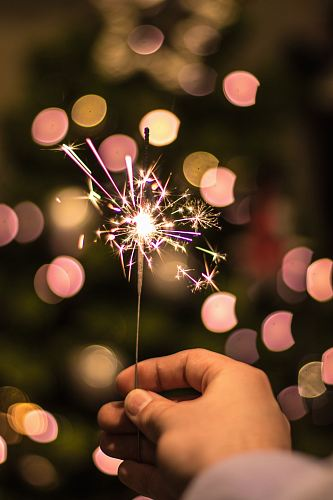 photo bokeh photography of person holding fireworks free for commercial use images