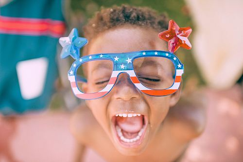 photo boy wearing American flag print eyeglasses sticking his mouth open free for commercial use images
